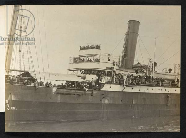 """""""'Komagata Maru' and her Hindoo passengers"""", View of the the forward section of the 'Komagata Maru,' moored at Vancouver, her decks crowded with Indian passengers, 1914 (b/w photo)"""