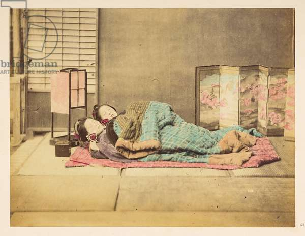 Japanese woman sleeping, Studio portrait of two Japanese women asleep under padded rugs,   Photographer: Unknown Lucas Collection: Photographic record of the world tour of Charles James and Morton P,  Lucas, 1877-79, Dimensions: 188 mm x 244 mm