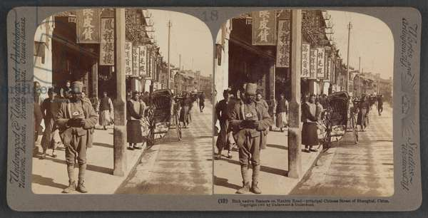 Rich native bazaars on Nankin Road, principal Chinese street in the English Settlement, Shanghai, c.1900 (stereoscopic photo)