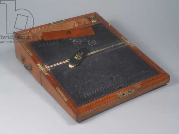 Portable writing desk that belonged to Jane Austen. Open. Spectacles and case.