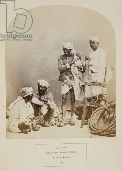 Lodhas. Low caste Hindoo tribe. Rajpootana. A group of four men with agricultural implements