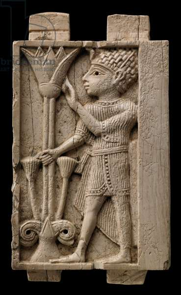 Plaque depicting an Egyptian man holding a lotus flower, Phoenician art from Nimrud, Mesopotamia, c.9th-8th century BC (ivory)