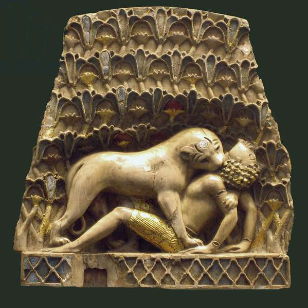 Plaque depicting a lioness attacking a boy, Nimrud, 899-700 BC (ivory)