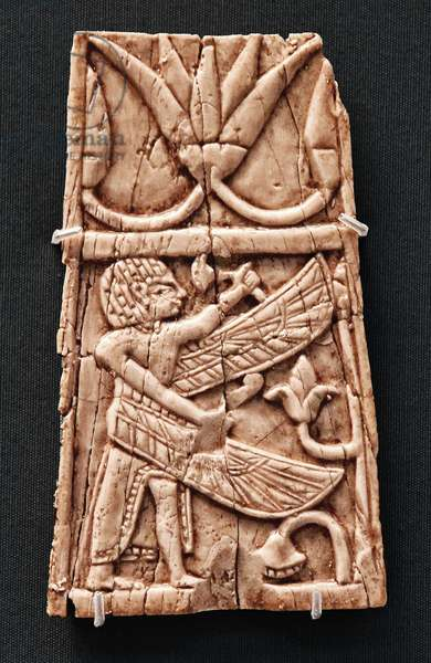 Plaque depicting a winged Egyptian man holding a flower, Nimrud, Mesopotamia (today Iraq) c. 9th-8th century BC (ivory)