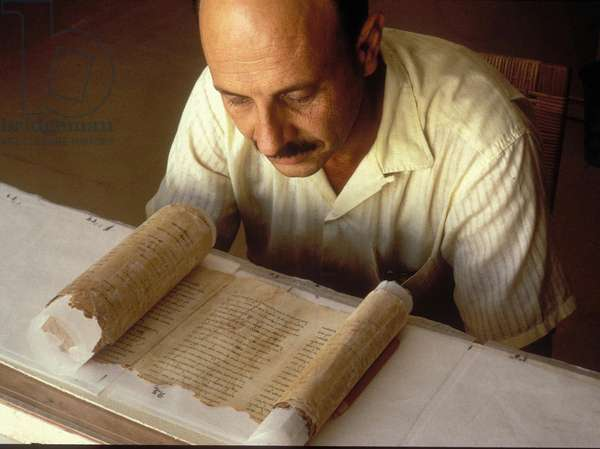 Professor Yigael Yadin working on one of the 'Dead Sea Scrolls' (photo)