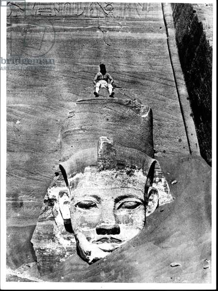 Egyptian Seated on a Colossal Figure of the King, from the Great Temple of Ramesses II in Abu Simbel, 29th March 1850 (b/w photo)
