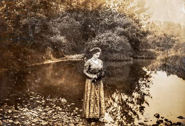 Portrait of woman on the edge of a pond, c.1915 (silver gelatin print)