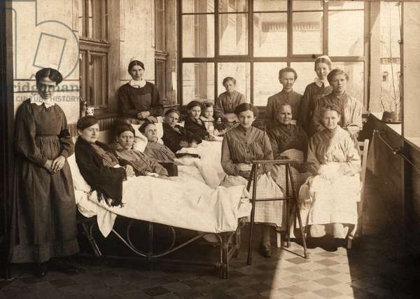 Female Tuberculosis Patients Rest on Enclosed Porch with Nurses, Leipzig, Germany, 1917 (postcard)