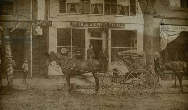 Dr. Yale's Drug Store with Horse-Drawn Carriages, c.1878 (silver gelatin print)