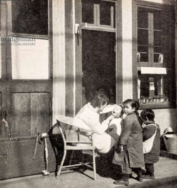 Sister Jagger Checking a Child's Teeth, Cheeloo University, Shandong, China, c.1930 (postcard)
