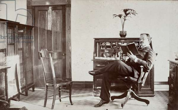 Doctor Reading Book in Office, c.1890 (silver gelatin print)