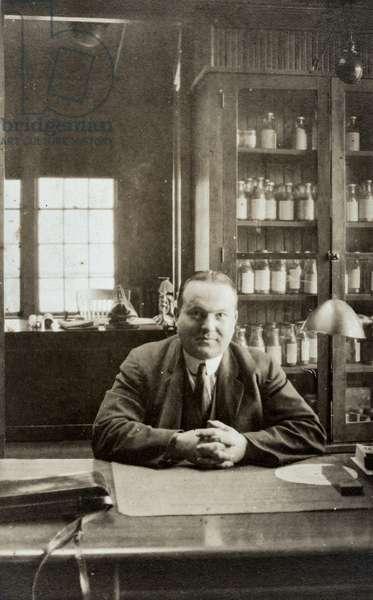 Doctor Sitting at Desk, c.1920 (silver gelatin print)