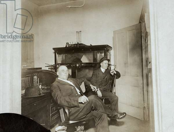 Two Men in Office with Electrotherapy Machine, c.1905 (silver gelatin print)