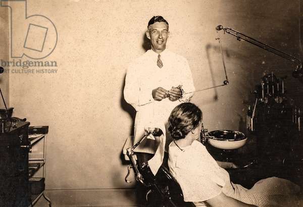 Dentist in Office with Patient, c.1920 (silver gelatin print)