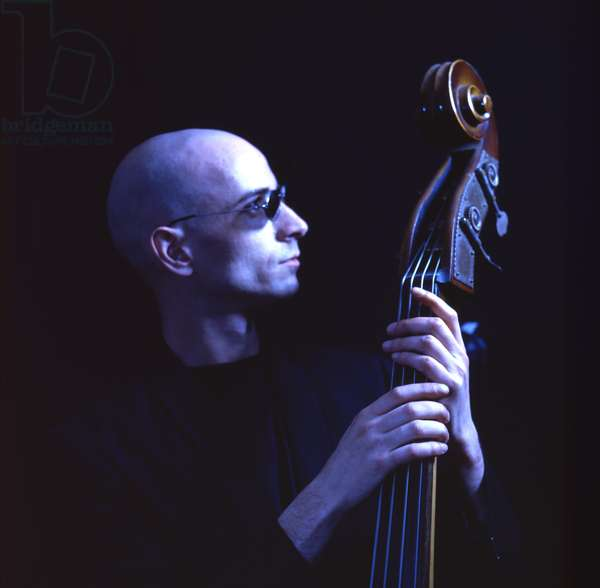 Musician holding double bass