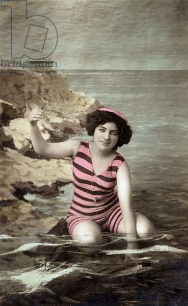 A bather with bathing suit, c. 1920, postcard
