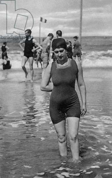 Bather with swimsuit at the sea, c. 1920, postcard