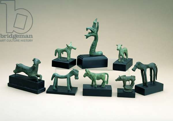 Collection of Greek bronze animals including a boar, a griffin and a running deer, ranging from the 8th to the 4th century BC (bronze)