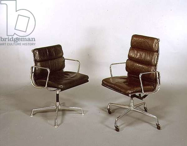 (LtoR) Soft Pad Arm Side Chair and high back Desk Chair, designed by Charles Eames (1907-78) 1969 (leather and tubular steel)