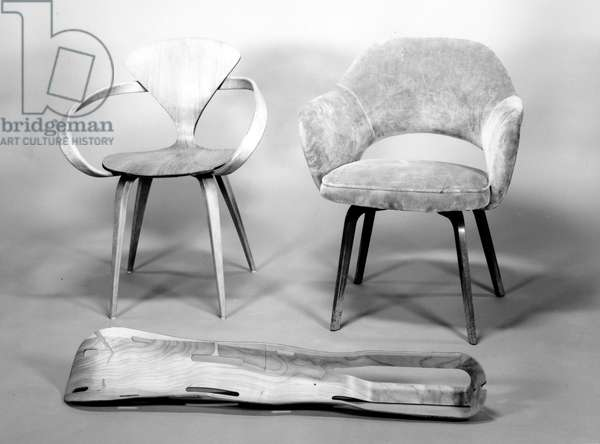 (front LtoR) Moulded Plywood Leg Splint, designed for Evans Products Co. by Charles and Ray Eames (1907-78, 1912-88) 1943, Cherner Chair, designed for Plycraft by Paul Goldman, 1956, and Arm Side Chair '71', designed for Knoll Associates by Eero Saarinen (1910-61) 1951 (plywood) (b/w photo)