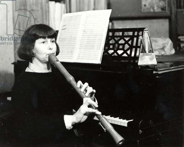 Sofia Gubaidulina playing tenor recorder, piano next to her