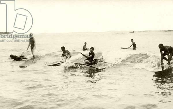 Classic image and perhaps the only known photo of Jack London (left) on a surfboard, c.1910 (b/w photo)