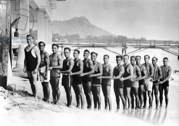Duke and members of the Hui Nalu club, with Moana Pier in the background on Waikiki Beach, c.1915 (b/w photo)