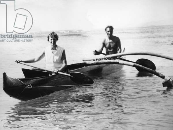 Amelia Earhart Putnam, America's First Lady of the Air, with Hawaiian swimming and surfing star Duke Kahanamoku, ACME News photo, January 11, 1935 (b/w photo)
