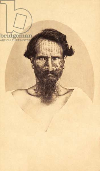 Carte-de-visite of a man with traditional tattoos from Papeete, Tahiti, photo by Mrs. S. Hoare, c.1910s (sepia photo)