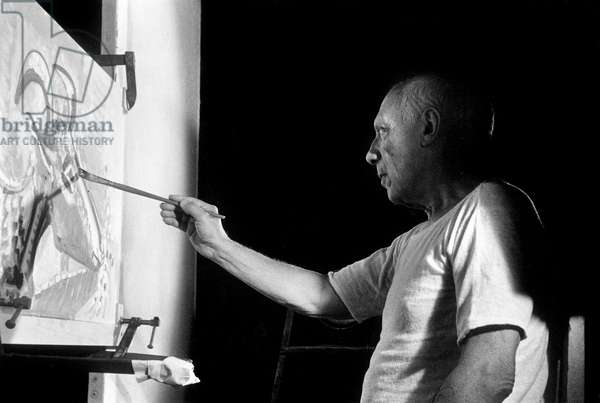 Painter Pablo Picasso painting on set of film The Mystery of Picasso in 1955