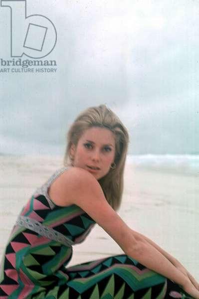 Catherine Deneuve on a beach in Brazil in 1966