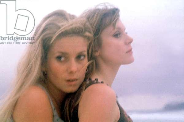 Catherine Deneuve and Francoise Dorleac on a beach in Brazil in 1966