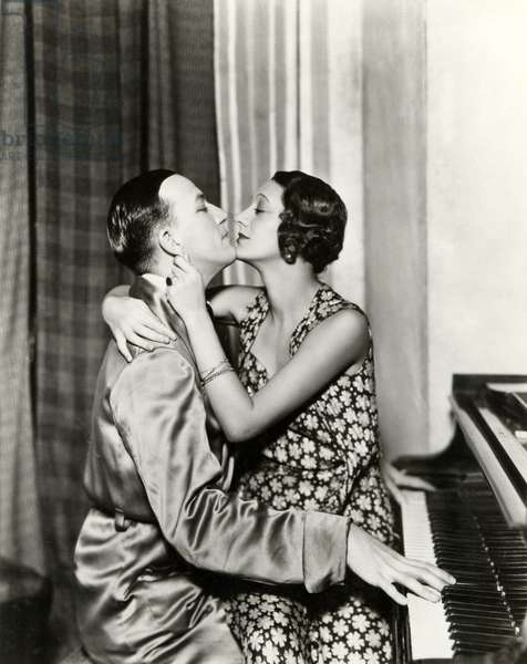 Scene from Noel Coward's ' Private Lives ' 1932 with Noel Coward at the piano and  Gertrude Lawrence   on his lap