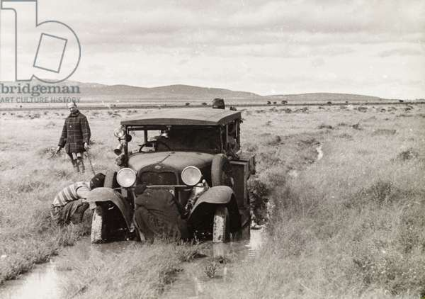 Car stuck in flooded plains, 1933-1934 (b/w photo) [1995/076/1/2/6/27]