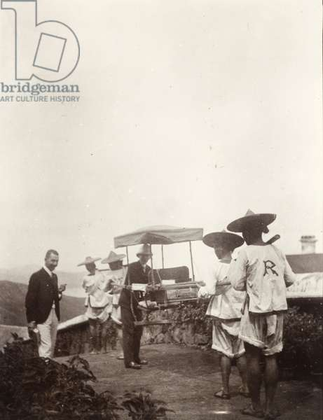Two doctors with a sedan chair, 1904 (b/w photo) [1998/028/1/1/104]