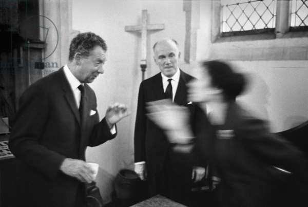 Benjamin Britten and Nina Richter in animated conversation after an Aldeburgh Festival concert, with Sviatoslav Richter behind them, Blythburgh Church, June 1964 (b/w photo)