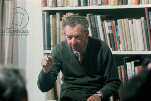 Benjamin Britten conducting a choir rehearsal in his home, the Red House, in Aldeburgh, Suffolk, June 1976 (photo)