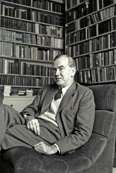 Graham Greene in his London apartment, 1957 (b/w photo)