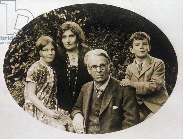 Poet W.B. Yeats with his daughter Anne, wife George, and son Michael (sepia photo)