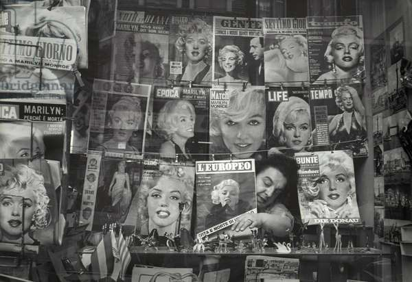 Magazine covers of Marilyn Monroe from around Europe on a London newspaper stand following her death, August 5, 1962 (b/w photo)