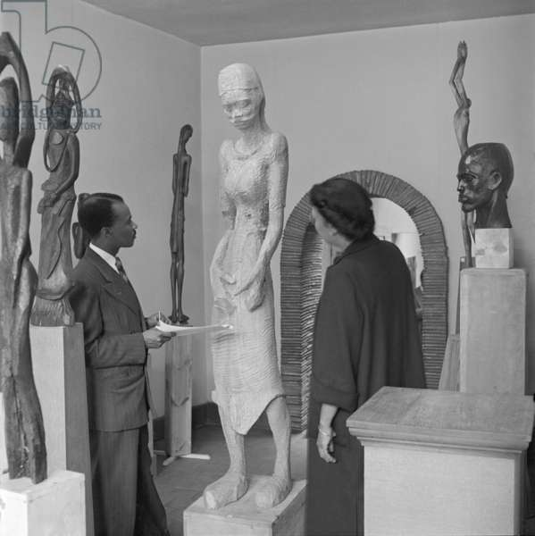 Ben Enwonwu with his sculptures (b/w photo)