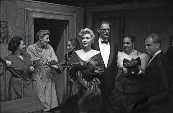"""Marilyn Monroe and her husband Arthur Miller in London for the opening night of Miller's new play """"A View from The Bridge"""", Comedy Theatre, October 11, 1956 (b/w photo)"""