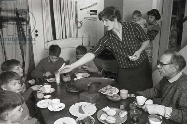 Terry Frost at dinner with his wife, five sons and baby daughter, St. Ives, Cornwall (b/w photo)