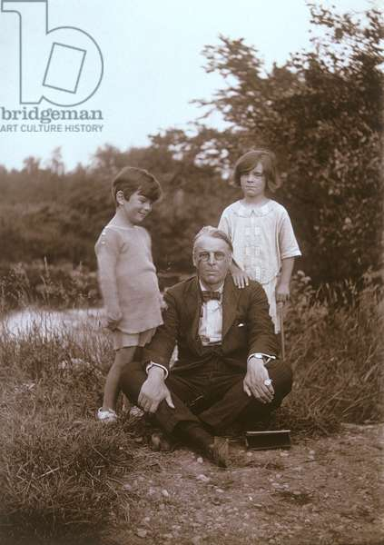 Poet William Butler Yeats with his son, Michael, and daughter, Anne, in the grounds of Thoor Ballylee, Gort, County Galway, Ireland (sepia photo)