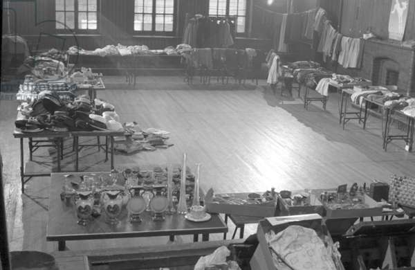 Sale of used clothing and household items in St. John's Wood, London, 1951 (b/w photo)