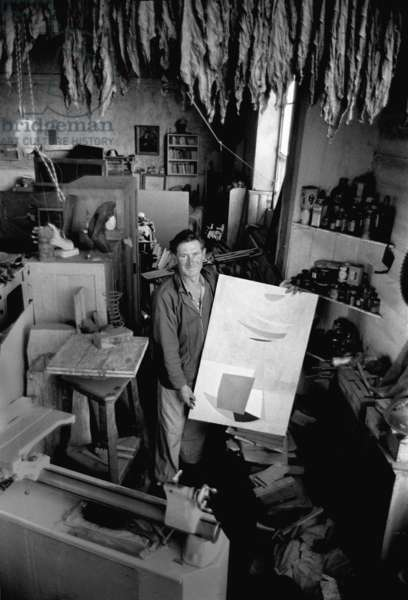 Roger Hilton in his St. Ives studio, Cornwall, 1954 (b/w photo)
