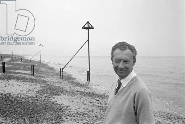 Benjamin Britten on the beach at Aldeburgh, Suffolk, England, 1963 (b/w photo)
