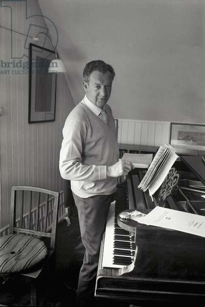 Benjamin Britten at the piano in his study at the Red House, Aldeburgh, Suffolk, June 1964 (b/w photo)
