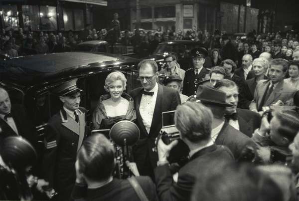 Marilyn Monroe and her husband Arthur Miller arrive for the opening night of Miller's new play