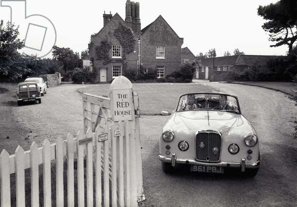 Benjamin Britten leaving his home, the Red House, Aldeburgh, Suffolk, June 1964 (b/w photo)